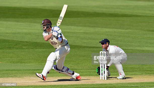 Surrey batsman Kevin Pietersen hits out watched by Glamorgan wicketkeeper Mark Wallace during day four of the LV County Championships Division Two...