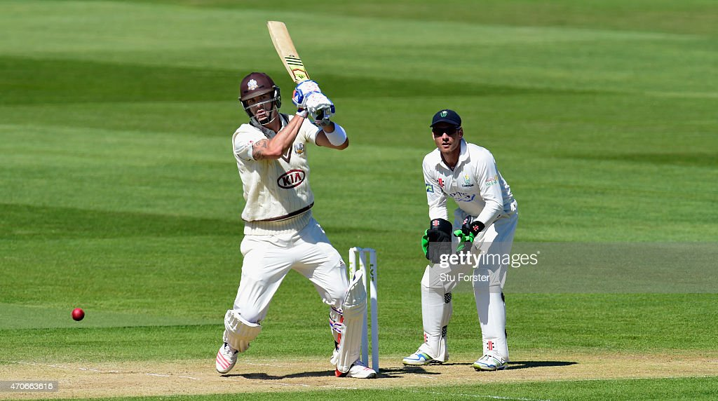 Surrey batsman <a gi-track='captionPersonalityLinkClicked' href=/galleries/search?phrase=Kevin+Pietersen+-+Cricketspieler&family=editorial&specificpeople=202001 ng-click='$event.stopPropagation()'>Kevin Pietersen</a> hits out watched by Glamorgan wicketkeeper Mark Wallace during day four of the LV County Championships Division Two match between Glamorgan and Surrey at SWALEC Stadium on April 22, 2015 in Cardiff, Wales.