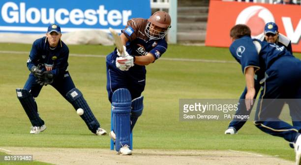 Surrey batsman Mark Butcher glances a delivery from Kent bowler Simon Cook as wicketkeeper Niall O'Brien looks on during the Cheltenham Gloucester...