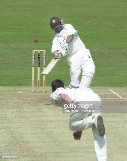 Surrey batsman Saqlain Mushtaq hits Sussex bowler James Kirtley straight down the ground for a six during a county championship match at The Oval...
