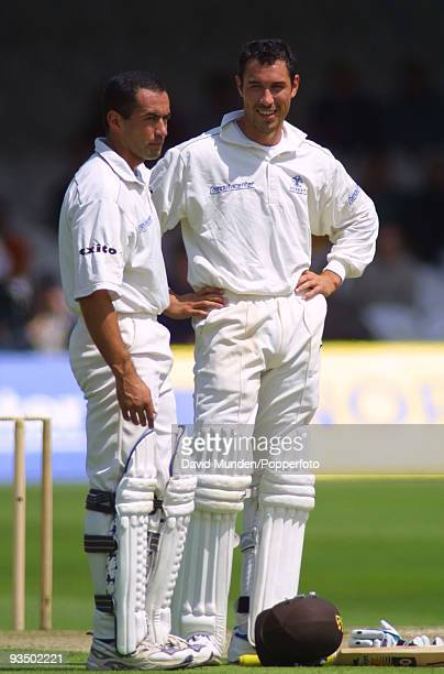 Surrey batsmen and brothers Adam and Ben Hollioake during their 84 run partnership that set the platform for Surrey to defeat Gloucestershire in the...