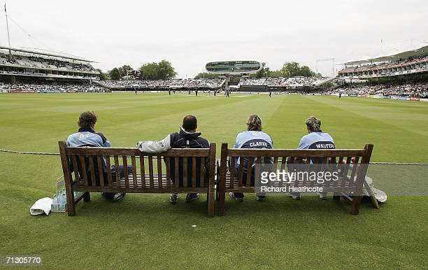 Surrey batsmen watch the openers start the game from the team bench during the Twenty20 Cup match between Middlesex and Surrey at Lord's on June 27...