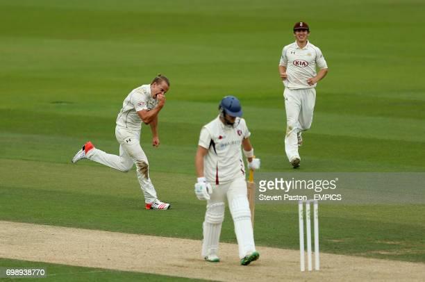 Surrey bowler Tom Curran celebrates the wicket of Kent's Sam Northeast
