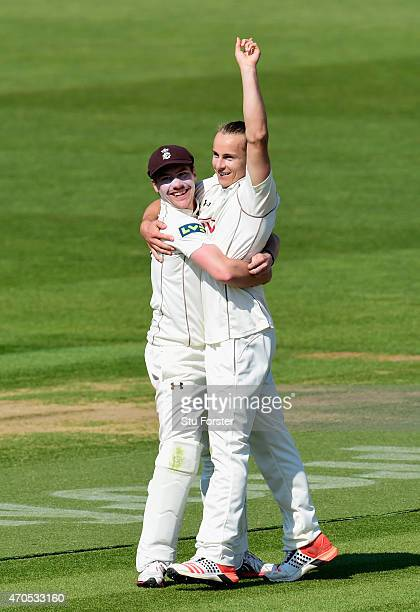 Surrey bowler Tom Curran celebrates with Rory Burns after dismissing Glamorgan batsman Mark Wallace during day three of the LV County Championships...