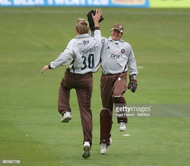 Surrey Brown Caps' Chris Schofield and Jon Batty celebrate after claiming the wicket of Hampshire Hawks' Michael Carberry