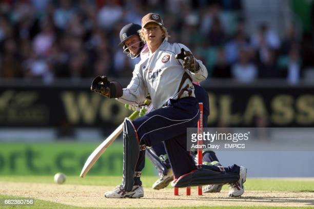 Surrey Brown Caps wicketkeeper Jonathan Batty looks on after Middlesex Crusaders' Ed Joyce plays a shot