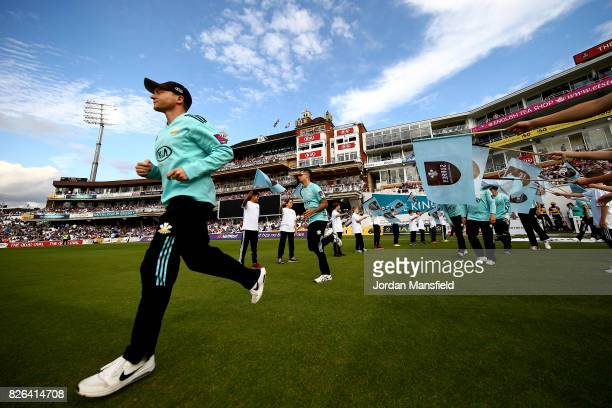 Surrey captain Gareth Batty leads his team onto the field ahead of the start of play during the NatWest T20 Blast match between Surrey and Glamorgan...