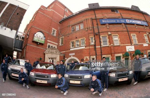 Surrey CCC players pose with Land Rovers from Harwood Rover