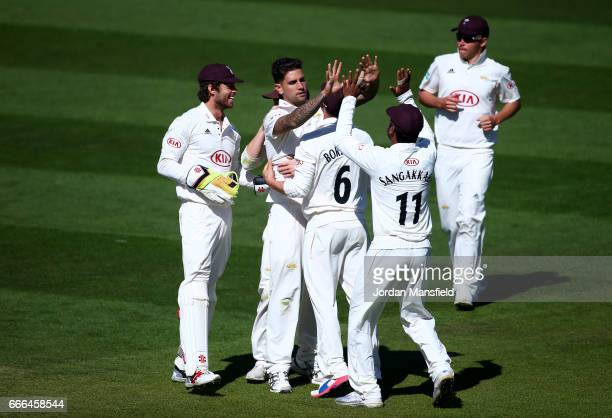 Surrey celebrate with Jade Dernbach after he gets the wicket of Sam Hain of Warwickshire during day three of the Specsavers County Championship...