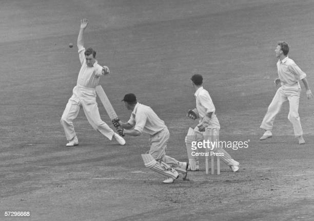 Surrey cricketer Jim Laker fails to catch a ball from Syd Brown of Middlesex at the Oval London 9th August 1955