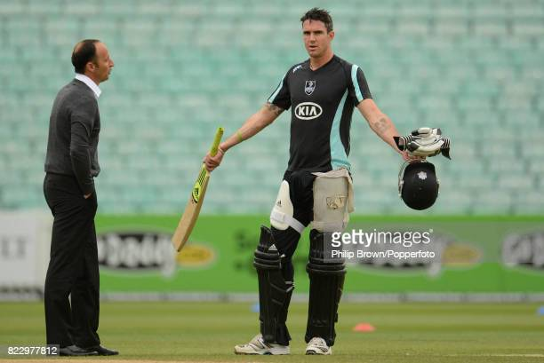 Surrey cricketer Kevin Pietersen talks with former England captain and Sky Sports commentator Nasser Hussain before the Clydesdale Bank 40 match...