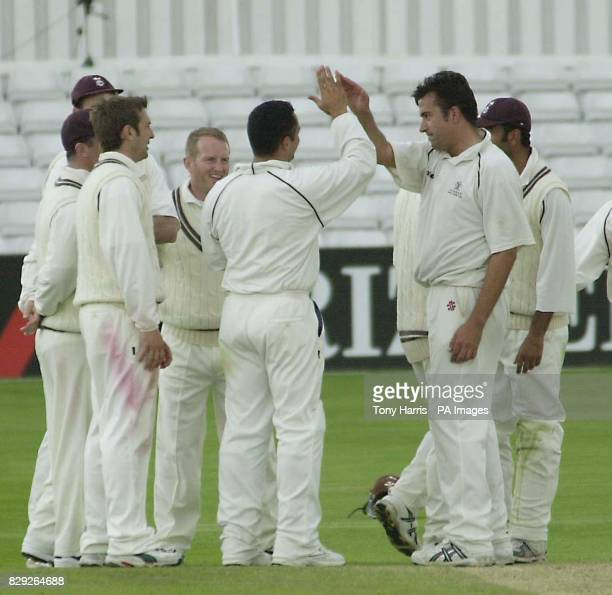 Surrey fast bowler James Ormond celebrates with his team mates after taking the wicket of Essex bastman Aftab Habib his fifth of the innings who was...