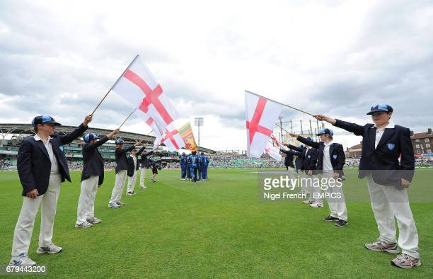 Surrey flag bearers form a guard of honour on the pitch before the game