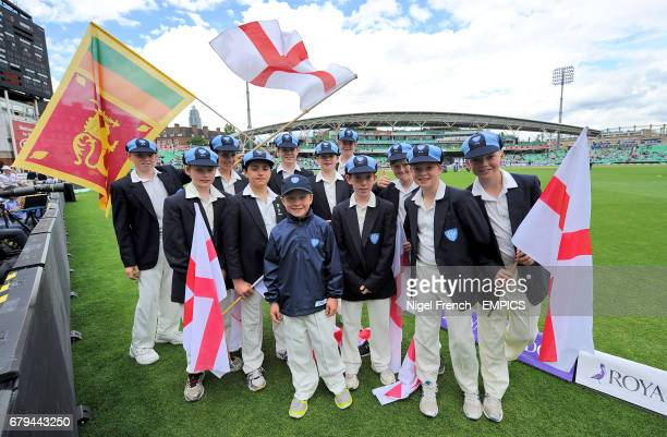 Surrey flag bearers on the pitch before the game