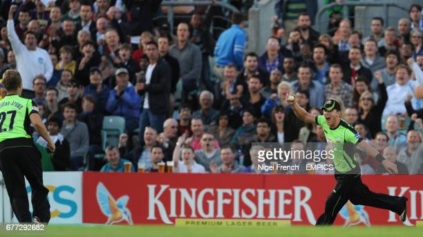 Surrey Lions' Stuart Meaker celebrates taking the catch on the boundary of Hampshire Royals' Shahid Afridi
