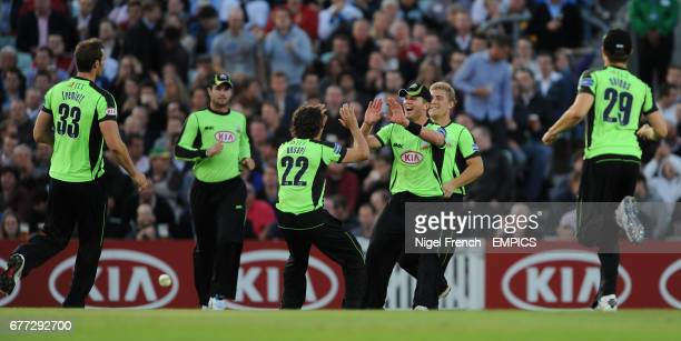 Surrey Lions' Stuart Meaker celebrates with bowler Zafar Ansari after catching Hampshire Royals' Shahid Afridi on the boundary