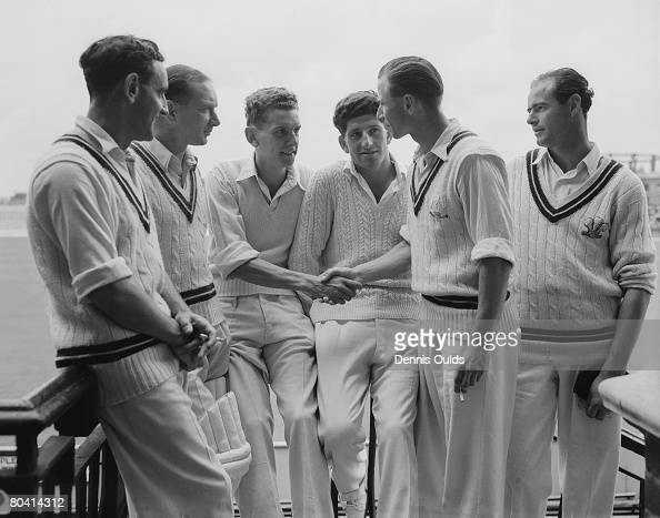 Surrey medium bowler Peter Loader is congratulated by teammate David Fletcher while Bernie Constable Arthur McIntyre Ken Barrington and John McMahon...