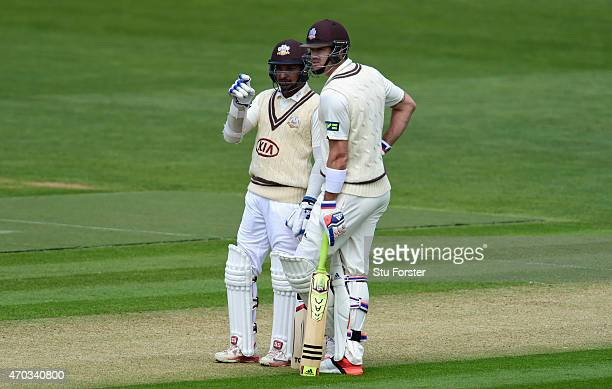 Surrey player Kevin Pietersen chats with batting partner Kumar Sangakkara during day one of the LV County Championships Division Two match between...