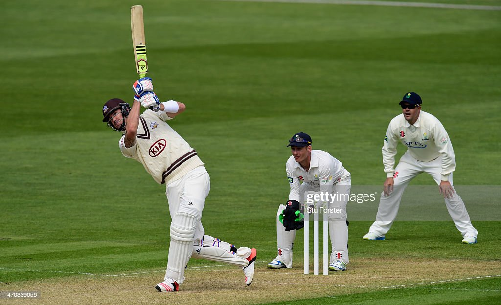 Surrey player <a gi-track='captionPersonalityLinkClicked' href=/galleries/search?phrase=Kevin+Pietersen+-+Cricket+Player&family=editorial&specificpeople=202001 ng-click='$event.stopPropagation()'>Kevin Pietersen</a> drives a ball to the boundary watched by Glamorgan captain Jaques Rudolph (r) and wicketkeeper Mark Wallace during day one off the LV County Championships Division Two match between Glamorgan and Surrey at SWALEC Stadium on April 19, 2015 in Cardiff, Wales.