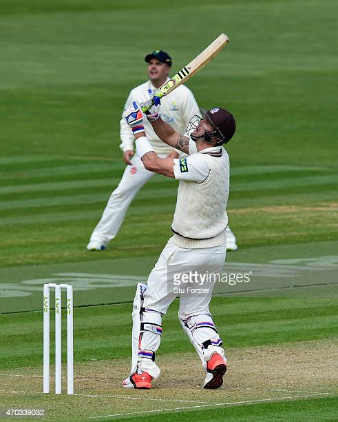 Surrey player Kevin Pietersen pulls a ball to the boundary watched by Glamorgan captain Jaques Rudolph during day one off the LV County Championships...