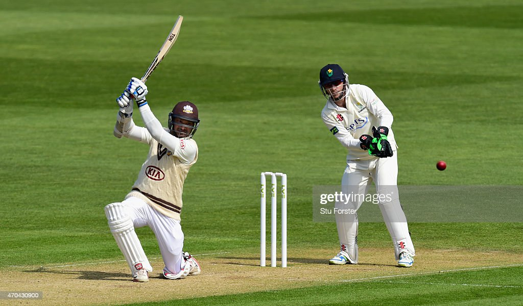 Surrey player Kumar Sangakkara picks up some runs watched by keeper Mark Wallace during day two of the LV County Championships Division Two match...