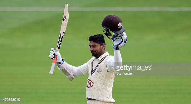 Surrey player Kumar Sangakkara reaches his century during day one of the LV County Championships Division Two match between Glamorgan and Surrey at...