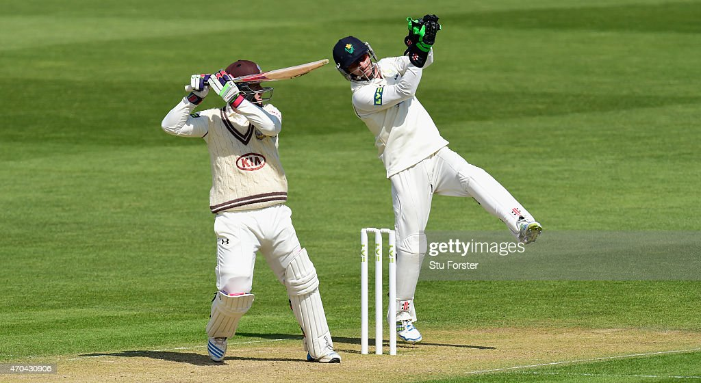 Surrey player Steven Davies picks up some runs watched by keeper Mark Wallace during day two of the LV County Championships Division Two match...