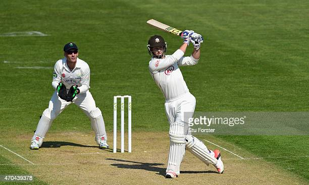 Surrey player Tom Curran hits out watched by keeper Mark Wallace during day two of the LV County Championships Division Two match between Glamorgan...