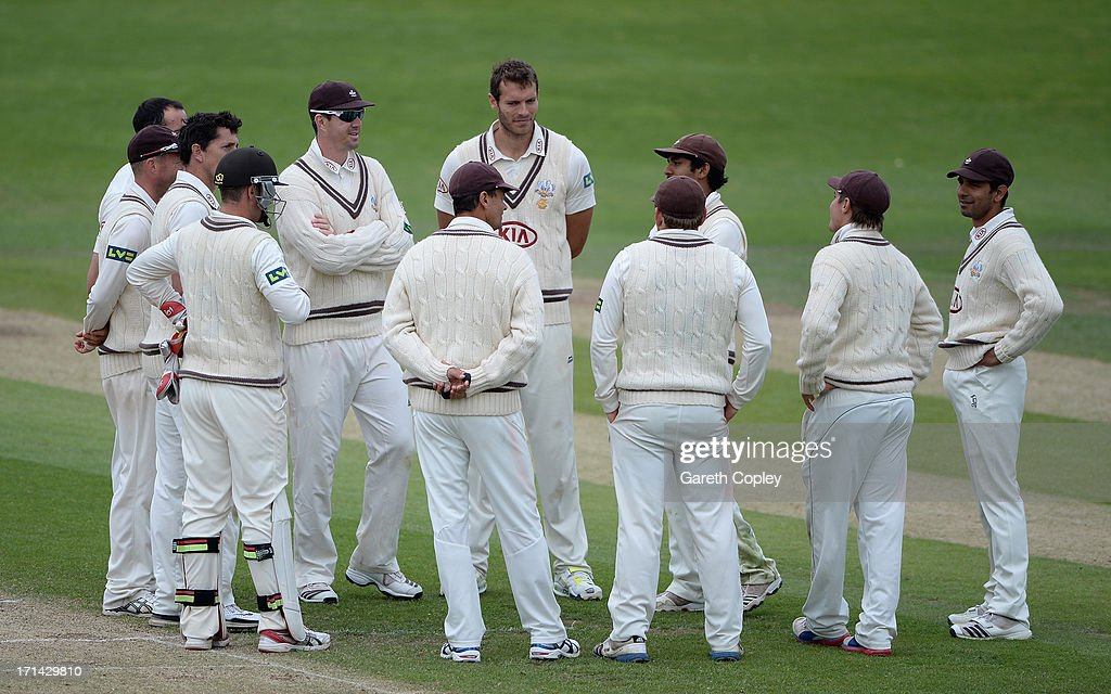 Surrey players huddle during day four of the LV County Championship Division One match between Yorkshire and Surrey at Headingley on June 24, 2013 in Leeds, England.