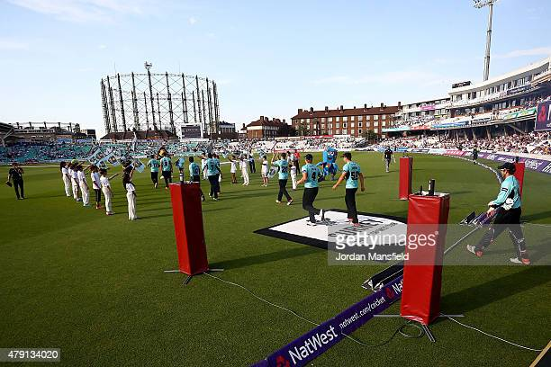 Surrey players make their way onto the field ahead of the Natwest T20 Blast match between Surrey and Gloucestershire at The Oval on July 1 2015 in...