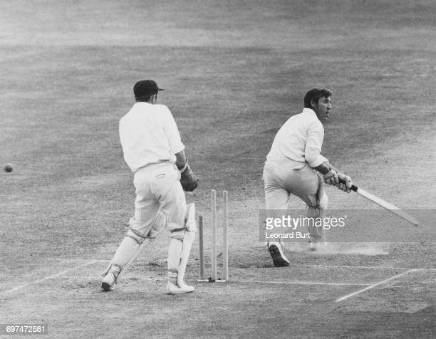 Surrey wicket keeper Arnold Long looks on as Peter Parfitt the captain of Middlesex is clean bowled on the leg stump after scoring 133 during their...