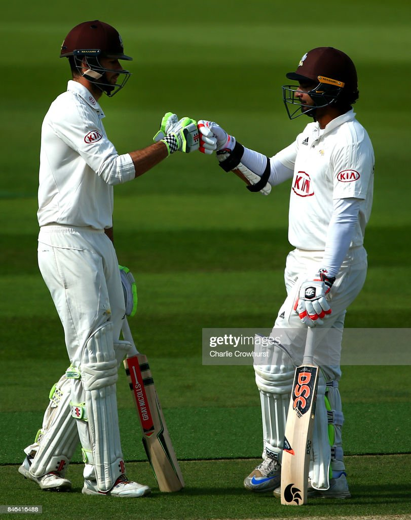 Surrey's Ben Foakes (L) and Kumar Sangakkara (R) chat in the middle as they put on a partnership of 258 during day two of the Specsavers County Championship Division One match between Surrey and Yorkshire at The Kia Oval on September 13, 2017 in London, England.