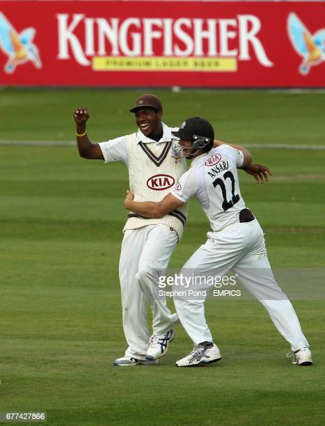 Surrey's Chris Jordan celebrates catching Derbyshire's Ross Whiteley with team mate Zafar Ansari