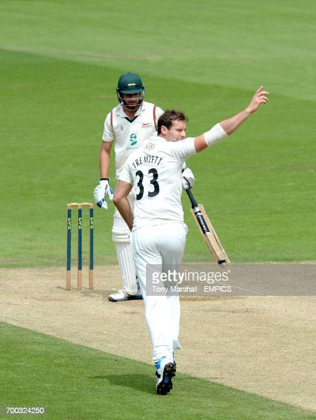 Surrey's Chris Tremlett celebrates after taking the wicket of Leicestershire's Nathan Buck