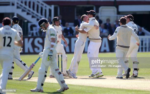Surrey's Gareth Batty celebrates with Graeme Smith after taking the wicket of Middlesex's Dawid Malan for 13 during the LV=County Championship...