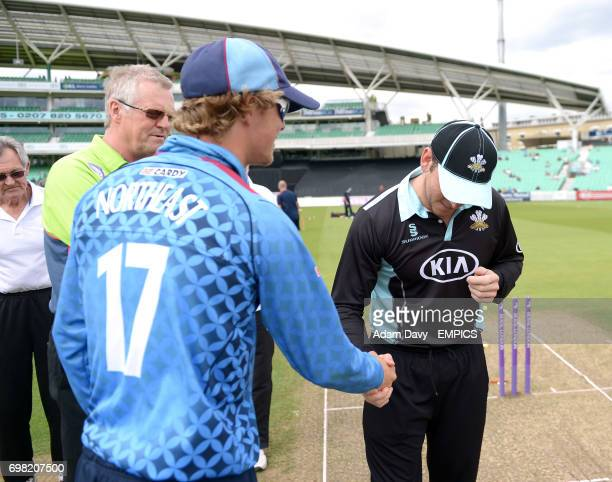Surrey's Gary Wilson shakes hands with Kent's Sam Northeast after the coin toss