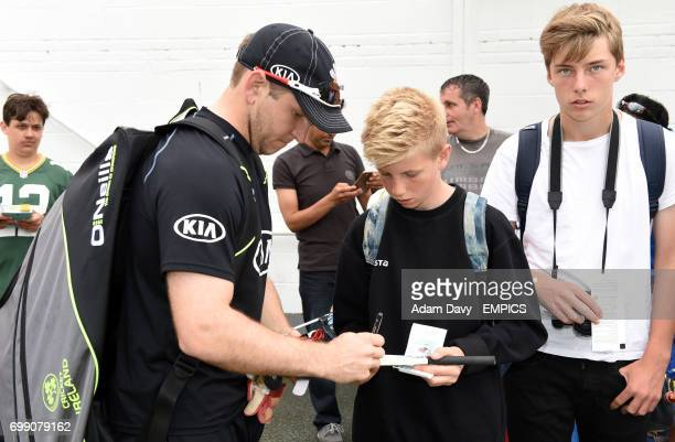 Surrey's Gary Wilson signs autographs for fans before the game