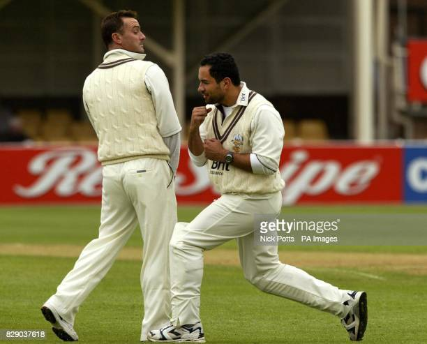 Surrey's Graham Thorpe keeps his chin away from his former captain Adam Hollioake's right hand during a playfull bout of shadow boxing while waiting...