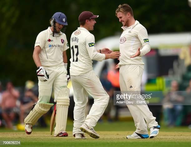 Surrey's Jason Roy celebrates taking the wicket of Kent's Sam Northeast