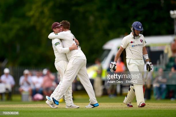 Surrey's Jason Roy celebrates taking thee wicket of Kent's Sam Northeast with teammate Rory Burns