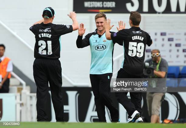 Surrey's Jason Roy celebrates with Jason O'Brien and Tom Curran after taking the catch of Kent Spitfires' Sam Northeast