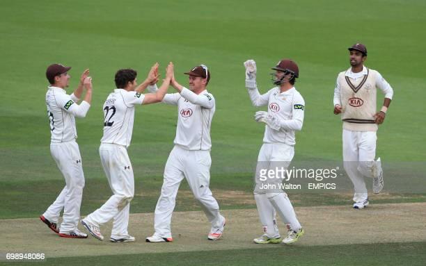 Surrey's Jason Roy congratulates Zafar Ansari on taking the wicket of Kent's Sam Northeast for 33