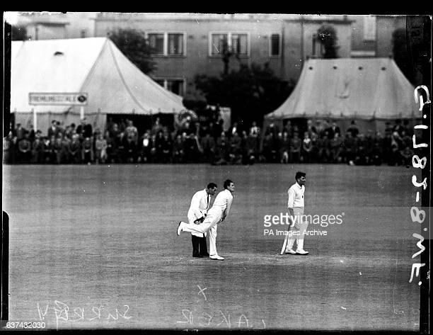 Surrey's Jim Laker bowling