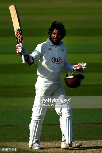 Surrey's Kumar Sangakkara celebrates his century during day two of the Specsavers County Championship Division One match between Surrey and Yorkshire...