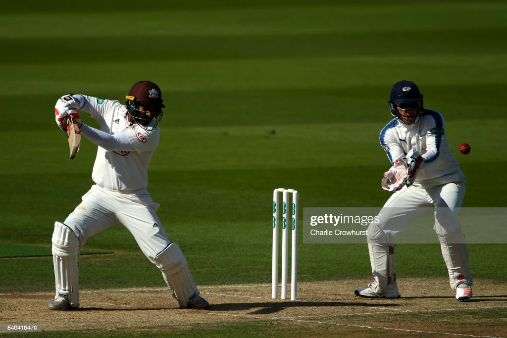 Surrey's Kumar Sangakkara hits out while Andy Hodd of Yorkshire tends the wicket during day two of the Specsavers County Championship Division One match between Surrey and Yorkshire at The Kia Oval on September 13, 2017 in London, England.