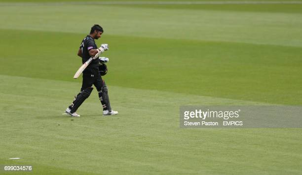 Surrey's Kumar Sangakkara walks of the field after being caught by Yorkshire Andrew Gale