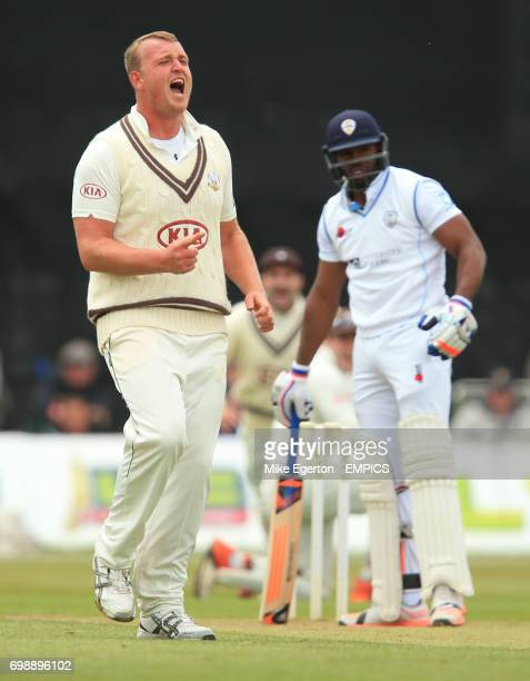Surrey's Luke Fletcher celebrates the wicket of Derbyshire's Chesney Hughes