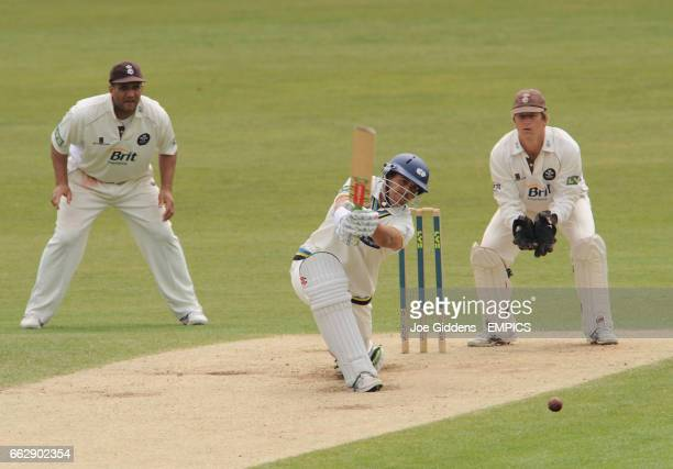 Surrey's Mark Butcher and Jonathan Batty look on as Yorkshire's Andrew Gale hits out
