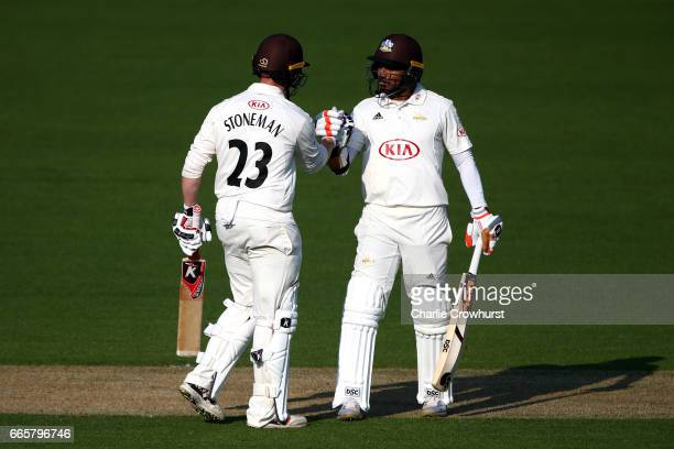 Surrey's Mark Stoneman celebrates his one hundred and fifty with team mate Kumar Sangakkara during the Specsavers County Championship Division One...