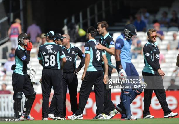 Surrey's players celebrate the wicket of Derbyshire's Chesney Hughes